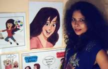 Indian cartoonist Kanika Mishra next to her cartoon creation, Karnika Kahen.