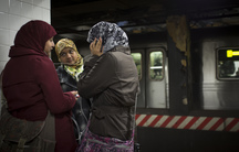Three women wearing hijab, the headscarf worn by some Muslim women, on a platform in the New York City subway. Australians feared that Muslims on public transportation would be harassed following the Sydney hostage crisis.