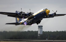 """The US Marine Corps C-130 Hercules named """"Fat Albert,"""" assigned to the US Navy """"Blue Angels"""" flight demonstration team, uses Jet Assisted Take Off bottles during the 2005 Blue Angel Homecoming show."""
