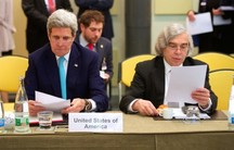 US Secretary of State John Kerry and US Energy Secretary Dr. Ernest Moniz sit side-by-side on April 2, 2015, in Lausanne, Switzerland, before the P5+1 member nations held a meeting to discuss ongoing nuclear negotiations with Iran.