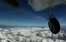 NASA's Airborne Snow Observatory flies above the Sierra Nevada mountain range in California.
