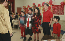 """Four members of the Huang family at a Chinese New Year celebration in the show """"Fresh Off the Boat"""""""