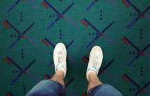 Standing on the soon-to-be-removed carpet at Portland's airport.