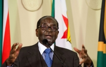 Zimbabwe President Robert Mugabe addresses members of the media