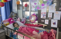 MSF staff working in Ramtha Hospital (Jordan, near the Syrian border), where war wounded patients from Syria are being treated. MSF medical staff is doing rounds in the wards. The girl photographed lost one leg due to artillery injury.