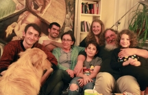 The Jellinek family in their home in Berlin, with their houseguest, Kinan, a Syrian Muslim refugee (second from left). When Chaim Jellinek told Kinan he was Jewish, Kinan said he had no problem with that.