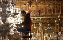 A worker prepares lights ahead of Christmas celebrations in the Church of the Nativity in the West Bank city of Bethlehem, Dec. 19, 2017.