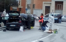 Forensics inspect a car used by a gunman in Macerata, Italy, Feb. 3, 2018.