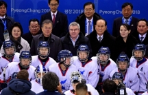 South Korea president Jae-in Moon; IOC president Thomas Bach; North Korea nominal head of state Kim Long-nam; and Kim Yo-jong, sister of North Korean leader Kim Jong-un with the Korean women's hockey team