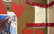 Red police tape and a photograph are seen on the front door of the appartment of Mireille Knoll in Paris, France, March 27, 2018.