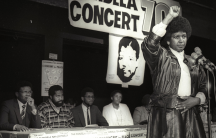 Winnie Mandela raises her fist in a black power salute after announcing that a massive pop concert will be held to mark the 70th birthday of her jailed husband Nelson Mandela, in 1988.