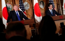 U.S. President Donald Trump and Japan's Prime Minister Shinzo Abe stand at podiums and hold a news conference at Akasaka Palace in Tokyo, Japan on November 6, 2017.