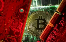 A copy of bitcoin standing on PC motherboard is seen in this illustration picture, October 26, 2017