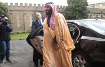 The Crown Prince of Saudi Arabia Mohammed bin Salman walks from a black car toward Lambeth Palace, London.