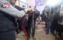 A man is washed following alleged chemical weapons attack, in what is said to be Duma, Syria in this still image from video obtained by Reuters on April 8, 2018.
