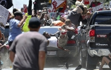 People fly into the air as a vehicle is driven into a group of protesters demonstrating against a white nationalist rally in Charlottesville, Virginia, in August 2017.
