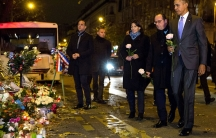 Former President Barack Obama, French President François Hollande and Paris Mayor Anne Hidalgo visit the memorial for victims of the Bataclan terrorist attack in Paris. November 30, 2015.