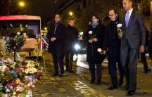 Former President Barack Obama, French President François Hollande and Paris Mayor Anne Hidalgo visit the memorial for victims of the Bataclan terrorist attack in Paris. November 30, 2015.