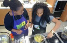 Class instructor Chioma Woko preparing braised cabbage.