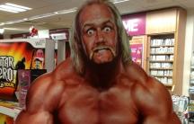 A poster of professional wrestler Hulk Hogan mugging for the camera.