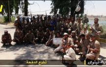 This photo purportedly shows an ISIS class of 2014 martial arts graduation photo, and in the background, a bridge spanning a large river.