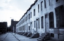 A row of abandoned houses in Baltimore, Maryland. Much of the city's housing stock is old and in disrepair, hurting the city's ability to retain its citizens.