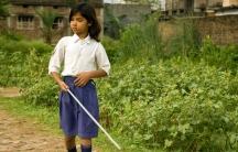 A girl named Kajal walks during mobility training at the Bihar Natraheen Parishad, or Bihar School for Blind Girls, in Patna, India, in 2009.