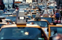 """Traffic piles up in New York City's Times Square. New York is one of the cities that attempted to introduce """"congestion pricing"""" — fees for driving at peak hours — but the plan was defeated."""