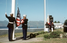US Marines raise the American flag for the last time at Subic Bay naval base in the Philippines, as their Philippine counterparts raise their ensign for the first time, at the start of the base de-activation ceremony, November 24th, 1992.