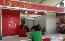 A booth serving Chifa booth at a food conference.