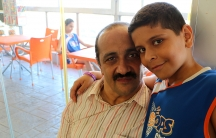 Ahmad and his dad at Hoops, an indoor basketball school made possible by a Lebanese NGO called Nawaya.