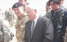 Afghan Ajmal Faqiri, wearing a scarf, served as a translator for former US Secretary of Defense Robert Gates