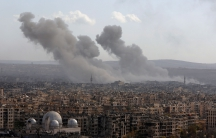 Smoke rises after strikes on Aleppo, Syria, December 3, 2016.
