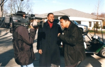 Tavis Smiley and Muhammad Ali speak during a TV interview.