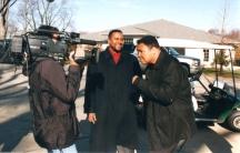 Tavis Smiley and Muhammad Ali speak during a TV interview.