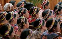 Women attend an evangelical church service in Almolonga, Guatemala.