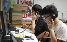 "Volunteers with Asian Americans Advancing Justice, an Los Angeles-based non-profit, work the phones to get Asian-American voters to the polls in California. The phone bank is part of the ""Your Vote Matters"" campaign, an effort to get 30,000 infrequent vot"