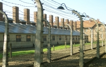 The barbed wire fence surrounding the labor camp at Auschwitz I. Johann Breyer says that he worked here as a guard during World War II and not at the nearby gas chambers at Auschwitz-Birkenau.