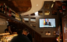 Spain's Prime Minister Mariano Rajoy is seen delivering a statement on a television screen at a bar in Barcelona, October 11, 2017.