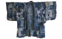 This is a patched work coat, or noragi, that likely never began as a full garment, but was rather made from multiple, very small patches — some of them the size of a postage stamp — that were all sewn together to create an area of cloth, and then layered.