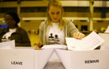 A workers counts ballots after polling stations closed in the Referendum on the European Union in Islington, London.