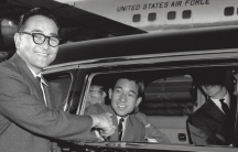 """Bruce Kaji, shaking the hand of Japan's Crown Prince who had just landed in Los Angeles on a US Air Force airplane, in 1961. """"In our family, we call this photo, The Prince and the Pauper.,"""" says Bruce's son, Jon."""