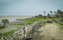At the tip of Sagar Island where it meets the Bay of Bengal battered earthen dikes no longer keep the sea at bay.