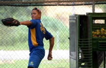 High school student Pedro Otero warms up his arm at the Carlos Beltran Baseball Academy in Puerto Rico.
