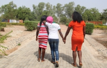 Ladi, Glory and Mary, three of the escaped Chibok girls, stroll through the gardens of the American University of Nigeria, in Yola, Nigeria. They've received scholarships to go to school at AUN.