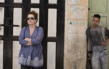 """Novelist Ayelet Waldman and a Palestinian man in Hebron. """"For most of my life, I loved Israel, I longed for Israel, I planned to live in Israel,"""" she says."""