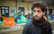 Ibrahim Esmael Ibrahim at the train station in Idomeni, Greece. As a teenager, he worked as a translator with the US military in Iraq.