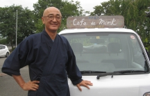 """Taio Kaneta with his signature """"Cafe de Monk"""" truck that he uses for his pop-up cafes. As a Buddhist monk, Kaneta wanted to offer something special to those still reeling from the triple disaster of earthquake, tsunami and nuclear meltdown."""