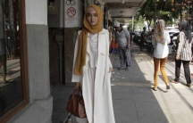 """Puteri Hasannah Karunia is a popular fashion blogger, one of Indonesia's generation of young Muslim fashionistas known as """"hijabers."""""""