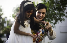 Ayesha Albusmait, and her daughter, Reem Abdullah Rashid. Albusmait is one of the small, but growing number of single Emirati woman choosing to adopt.